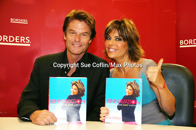 Harry Hamlin and Lisa Rinna show off her new book Rinnavation - Getting Your Best Life Ever at it debuts today, May 19. 2009 at Borders at Columbus Circle, New York City, New York. (Photo by Sue Coflin/Max Photos)