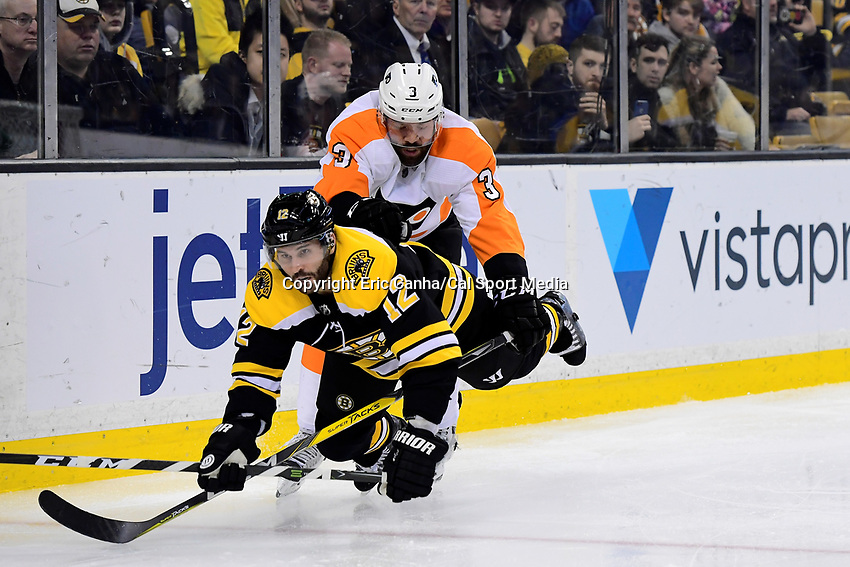 March 8, 2018: Philadelphia Flyers defenseman Radko Gudas (3) checks Boston Bruins right wing Brian Gionta (12) during the NHL game between the Philadelphia Flyers and the Boston Bruins held at TD Garden, in Boston, Mass. Boston defeats Philadelphia 3-2 in regulation time. Eric Canha/CSM