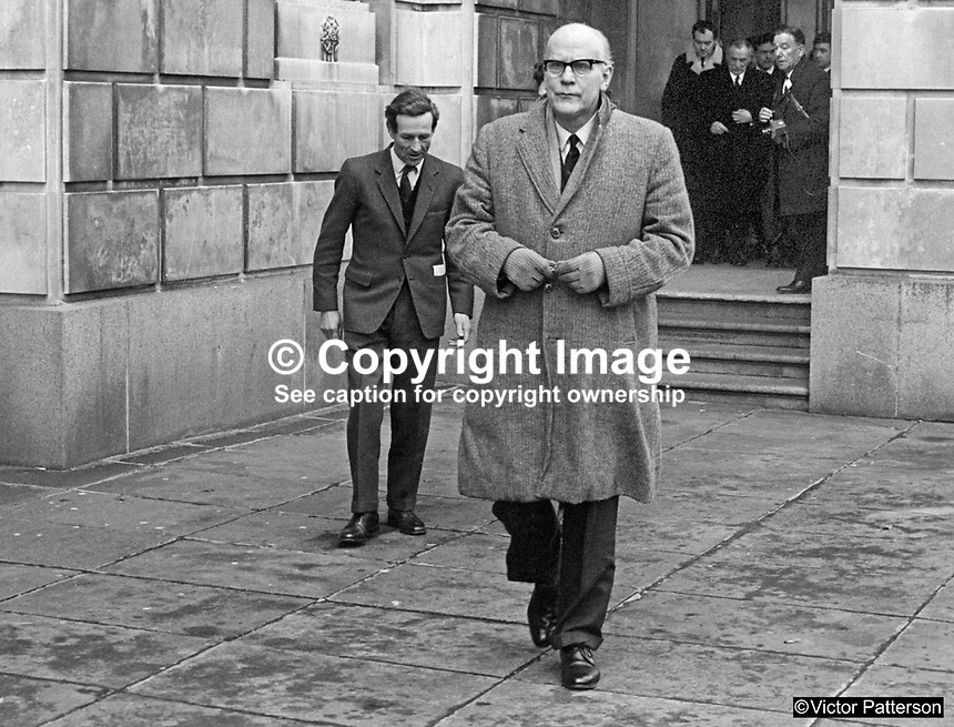 Ulster Unionist MPs leave Parliament Buildings, Stormont, Belfast, N Ireland, 28th February 1969 after first meeting of the parliamentary party following the General Election of 24th February 1969, a few days earlier. At the meeting ten or twelve MPs who opposed his leadership walked out led by John D Taylor. In the foreground is the Londonderry MP, Albert Anderson. Behind is Captain John Brooke who in 1973 became the 2nd Viscount Brookeborough. 196902280082d<br /> <br /> Copyright Image from<br /> Victor Patterson<br /> 54 Dorchester Park<br /> Belfast, N Ireland, UK, <br /> BT9 6RJ<br /> <br /> t1: +44 28 90661296<br /> t2: +44 28 90022446<br /> m: +44 7802 353836<br /> e1: victorpatterson@me.com<br /> e2: victorpatterson@gmail.com<br /> <br /> www.victorpatterson.com