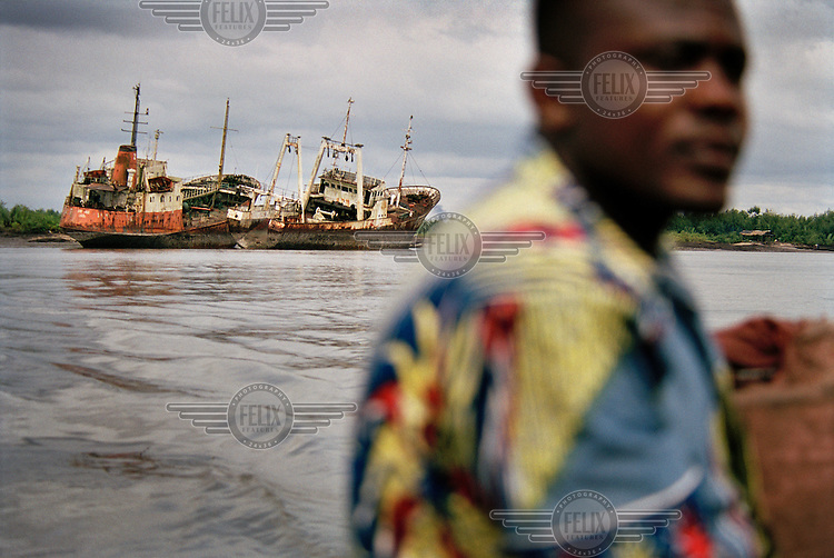 Wrecks of cargo boats line the creeks in the Niger Delta. The people of the delta say that they live in abject poverty amidst plenty. Very little of the oil wealth finds its way back to the people who live here, and the standard of living in the delta region has sunk since oil was discovered 40 years ago.