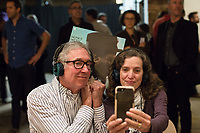 "Mickey Maloney and his wife Betsy (BOTH CQ take a selfie with their favorite Thelonious Monk album, ""Monk's Dream"" during the Monk @ 100 festival at the Durham Fruit and Produce Company in Durham, NC Wednesday, October 25, 2017. (Justin Cook for The New York Times)"