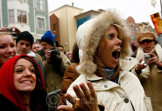 Park City, UT--1/20/07--3:39:18 PM--.Actress Cheryl Hines is surprised when Christian Slater arrives on Main Street during the Sundance Film Festival....*****************.Sundance '07: Saturday.. Chris Detrick/Salt Lake Tribune.File #_1CD5449....`