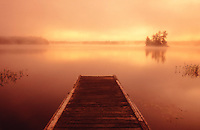 Canada, Ontario, Mackay Lake, sunrise at dawn with wooden pier  and island in distance
