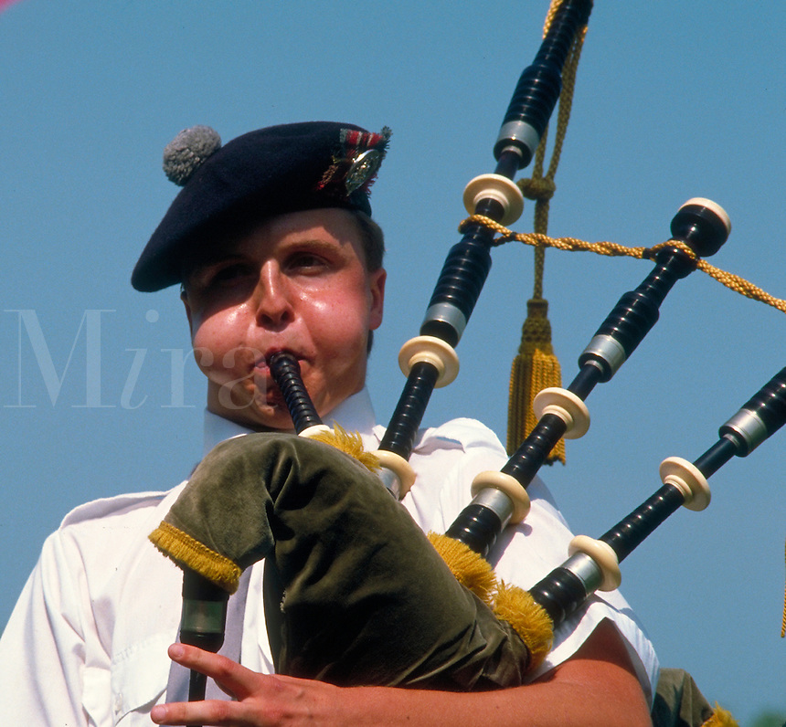 Man playing Bagpipe at Highland Games isn Fergus, Ontairo, Canada. Man playing Bagpipe. Fuergus Ontario Canada Highland Games.