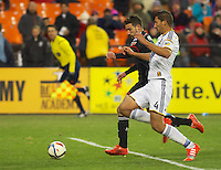 Chris Pontius and Omar Gonzales battle for the ball. DC United defeated the LA Galaxy 1-0 with a stoppage time goal from Chris Pontius at RFK Stadium in Washington DC.