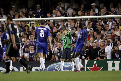 13 September 2005: Chelsea goalkeeper Petr Cech gives a signal to his team mates during the UEFA Champions League Group G game between Chelsea and Andrelecht at Stamford Bridge, London. Chelsea won the match 1-0. Photo: Glyn Kirk/Actionplus..050913 man men football footballer player goalie keeper 2 two
