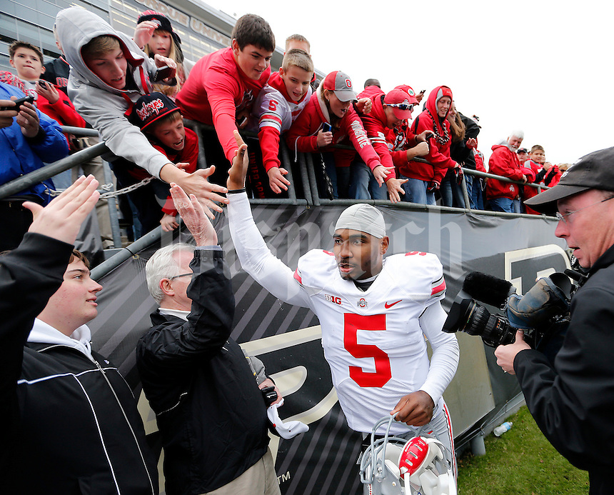 Ohio State Buckeyes quarterback Braxton Miller (5) high fives fans as he leaves the field following the team's 56-0 win over Purdue during the NCAA football game at Ross-Ade Stadium in West Lafayette, Ind. on Nov. 2, 2013. (Adam Cairns / The Columbus Dispatch)