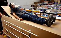BOGOTA, COLOMBIA - MAY 14: A worker makes a demonstration of a hospital bed which in case to be needed can be used as a coffin in Bogota, May 14, 2020. The bed was designed by a Colombian company for COVID-19 patients amid the new coronavirus pandemic that infected 12.930 people and claimed 509 lives in the country. (Photo by Leonardo Munoz/VIEWpress)