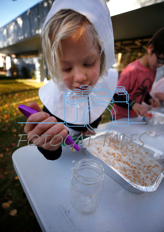Lyric Adams, 7, counts corn kernels during a game at the Boo-nanza event at the Carson City Library, in Carson City, Nev., on Tuesday, Oct. 30, 2018. <br /> Photo by Cathleen Allison/Nevada Momentum