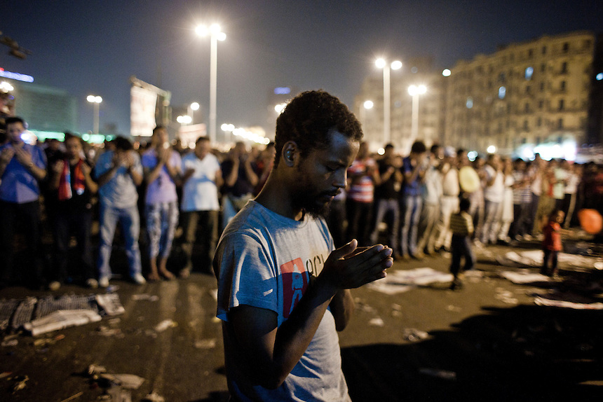 An Egyptian man bows his head in prayer during a protest in Cairo's Tahrir Square, Friday September 9, 2011. Hundreds of protesters gathered in central Cairo to 'correct the path' of the Egyptian revolution in the biggest protests in the city since July.