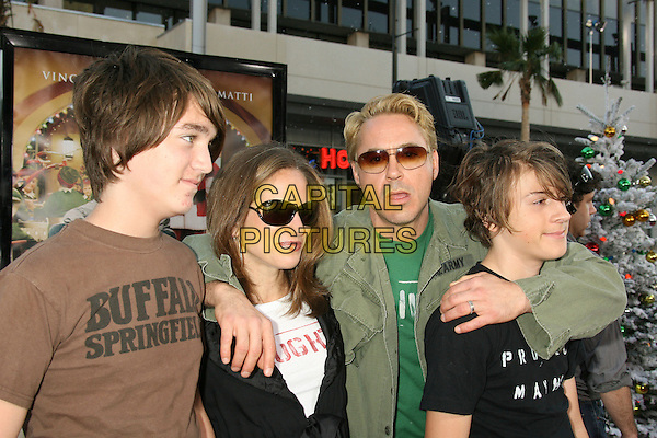 "GUEST, SUSAN LEVIN DOWNEY, ROBERT DOWNEY JR. & INDIO (SON).""Fred Claus"" Los Angeles Premiere held at Grauman's Chinese Theatre, Hollywood, California, USA..November 3rd, 2007.half length black t-shirt tee arms over shoulder kid son father mother husband wife family sunglasses shades brown green jacket mouth open funny face .CAP/ADM/RE.©Russ Elliot/AdMedia/Capital Pictures."