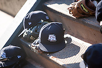 Colorado Springs Sky Sox caps on the dugout steps at the Chickasaw Bricktown Ballpark during the Pacific League game between the Oklahoma City RedHawks and the Colorado Springs Sky Sox on August 3, 2014 in Oklahoma City, Oklahoma.  The RedHawks defeated the Sky Sox 8-1.  (William Purnell/Four Seam Images)