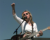 Melissa Ethridge raises a fist in the air after performing at the Million Mom March in favor of gun control on the Mall in Washington, DC on May 14, 2000..Credit: Ron Sachs / CNP