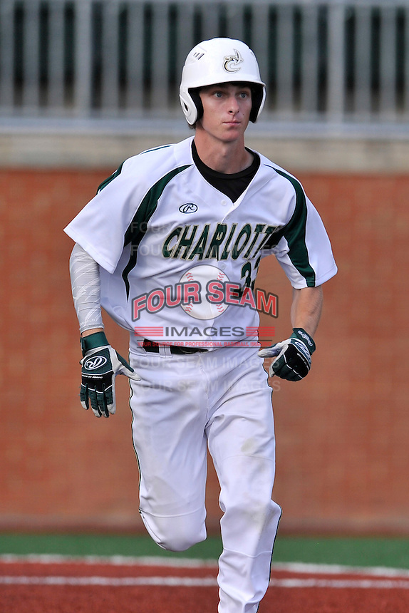Shortstop Hunter Jones (33) of the Charlotte 49ers runs toward first in a game against the Fairfield Stags on Saturday, March 12, 2016, at Hayes Stadium in Charlotte, North Carolina. (Tom Priddy/Four Seam Images)