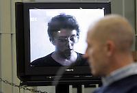 L'imputato Raniero Busco assiste alla proiezione di un'intervista ad Anna Di Gianbattista, madre della sua ex fidanzata Simonetta Cesaroni, durante l'udienza per il delitto di Simonetta, presso l'aula bunker di Rebibbia, Roma, 16 febbraio 2010..UPDATE IMAGES PRESS/Riccardo De Luca