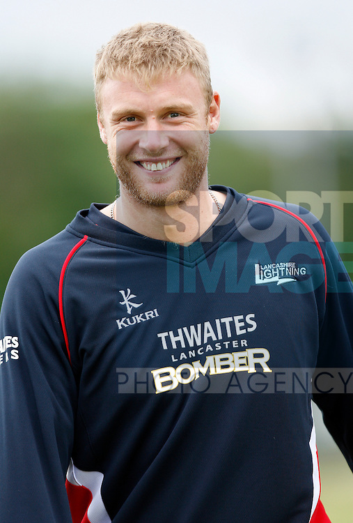 Lancashire's Andrew Flintoff inspect the pitch after a rain delay.