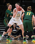 SIOUX FALLS, SD - MARCH 8: Vicky McIntyre #34 of Oral Roberts looks to make a move against defenders Taylor Thunstedt #11 and Liz Keena #21 of North Dakota State in the second half of their first round Summit League Championship Tournament game Sunday afternoon at the Denny Sanford Premier Center in Sioux Falls, SD(Photo by Dick Carlson/Inertia)