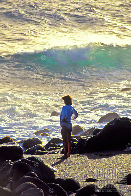 Woman standing on Orr's beach, Big island of Hawaii