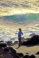 Woman standing on Orr's beach, Big island of Hawaii