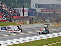 May 5, 2018; Commerce, GA, USA; NHRA top fuel driver Steve Torrence (left) races alongside Scott Palmer during qualifying for the Southern Nationals at Atlanta Dragway. Mandatory Credit: Mark J. Rebilas-USA TODAY Sports