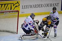 IJSHOCKEY: HEERENVEEN: THIALF: 16-01-2013, Friesland Flyers - Tilburg Trappers, Eindstand 1-3, goalie Martijn Oosterwijk (# 30), Aleksandr Terjohins (#4), ©foto Martin de Jong