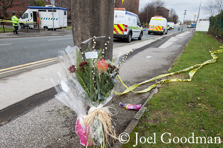 "© Joel Goodman - 07973 332324 . 27/12/2011 . Salford , UK . Flowers left at the scene reading "" Sorry we could not have done more . I was so sure you would pull through "". Police forensic scenes of crime examiners work at the scene of the murder of Anuj Bidve on Ordsall Lane . Bidve was shot and killed by Kiaran Stapleton on 26 December 2011 . Photo credit: Joel Goodman"