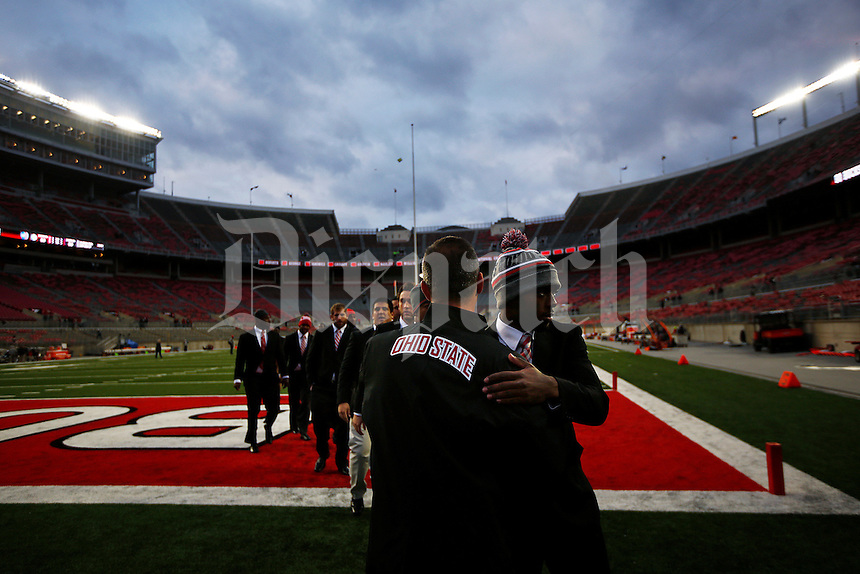 Ohio State Buckeyes head coach Urban Meyer hugs quarterback J.T. Barrett (16) as  the team enters the stadium before the college football game between the Ohio State Buckeyes and the Illinois Fighting Illini at Ohio Stadium in Columbus, Saturday night, November 1, 2014. (The Columbus Dispatch / Eamon Queeney)