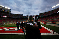 Ohio State Buckeyes head coach Urban Meyer hugs quarterback J.T. Barrett (16) as  the team enters the stadium before the college football game between the Ohio State Buckeyes and the Illinois Fighting Illini at Ohio Stadium in Columbus, Saturday night, November 1, 2014. (The Columbus Dispatch / Eamon Queeney)