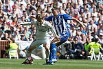 Luka Modric of Real Madrid competes for the ball with  Victor Laguardia Cisneros of Club Deportivo Alaves during the match of  La Liga between Real Madrid and Deportivo Alaves at Bernabeu Stadium Stadium  in Madrid, Spain. April 02, 2017. (ALTERPHOTOS / Rodrigo Jimenez)