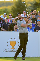 Marc Leishman (AUS) watches his tee shot on 18 during round 2 Four-Ball of the 2017 President's Cup, Liberty National Golf Club, Jersey City, New Jersey, USA. 9/29/2017.<br /> Picture: Golffile | Ken Murray<br /> <br /> All photo usage must carry mandatory copyright credit (&copy; Golffile | Ken Murray)