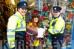 Garda Mary Gardiner collecting her prize on Monday, for naming Carmel Russel of Thats Perfect&rsquo;s spider Alan Shatter, from the competition to name the spider that was used due to the shop window been damaged before Halloween.<br /> L to r: Gda Mary Gardiner, Carmel Russell and Gda Cathy Murphy.
