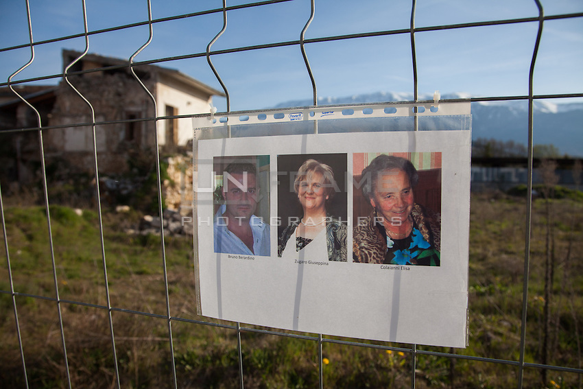 "Onna, a few Kilometres from L'Aquila, is a village that was almost completely erased by the earthquake of April 6, 2009.  85% of its old buildings went destroyed, killing 40. <br /> Thanks to the initiative ""Come era bella Onna"" (""How beautiful Onna was"") a path has been setup. It unfolds through the rubble of the houses that collapsed. On the occasion of the commemoration of the 6th anniversary of the earthquake, relatives of the victims hanged portraits in front of what remains of their respective houses.  Onna, Italy. April 10, 2015"