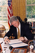 United States President Bill Clinton signs a directive to ensure US Treasury Department enforcement of the Youth Handgun Safety Act in the Oval Office of the White House in Washington, DC on June 11, 1997.<br /> Mandatory Credit: Robert McNeely / White House via CNP