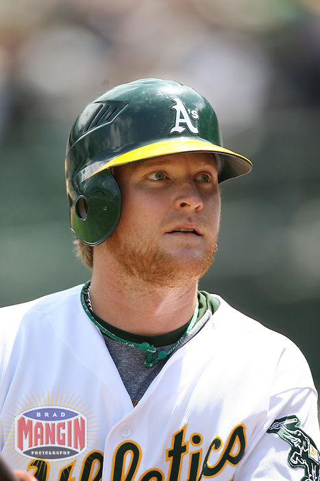OAKLAND, CA - May 12:  Dan Johnson of the Oakland Athletics waits in the on deck circle during the game against the Cleveland Indians at the McAfee Coliseum in Oakland, California on May 12, 2007.  The Indians defeated the Athletics 6-3.  Photo by Brad Mangin