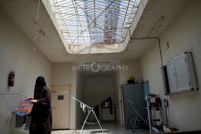 SULAIMANIA, IRAQ: A inmate finishes her laundry in the women's section of the local jail