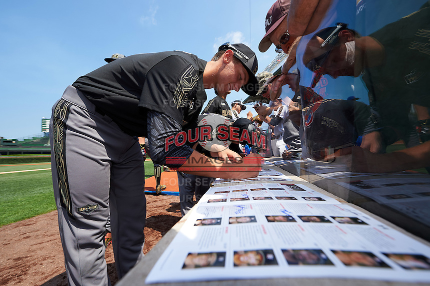 Grae Kessinger (11) of Oxford High School in Oxford, Mississippi signs autographs before the Under Armour All-American Game on August 15, 2015 at Wrigley Field in Chicago, Illinois. (Mike Janes/Four Seam Images)