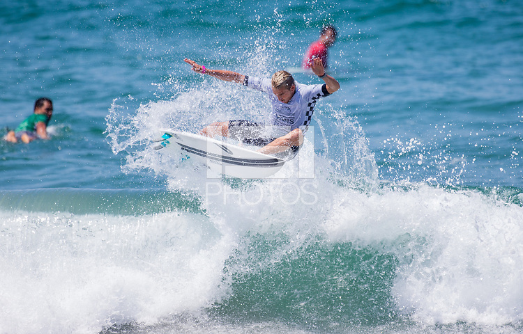 Huntington Beach, CA - Tuesday July 31, 2018: Charly Martin in action during a World Surf League (WSL) Qualifying Series (QS) Men's round of 96 heat at the 2018 Vans U.S. Open of Surfing on South side of the Huntington Beach pier.