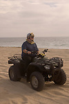 Man riding a Quad on the playa near Migrino, Baja California, Mexico