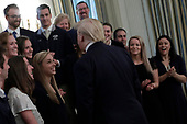 United States President Donald J. Trump greets athletes from the Queens University Charlotte Swim Team as part of NCAA Collegiate National Champions Day at the White House in Washington on November 22, 2019. <br /> Credit: Yuri Gripas / Pool via CNP