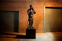The Jimmy Fund statue of Ted Williams giving a cap to a young boy with cancer stands outside Fenway Park in Boston, Massachusetts, USA.