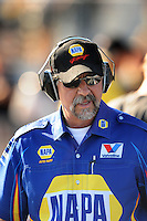 Sept. 19, 2010; Concord, NC, USA; NHRA crew chief John Medlen wears hearing protection during the O'Reilly Auto Parts NHRA Nationals at zMax Dragway. Mandatory Credit: Mark J. Rebilas-