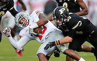 Ohio State Buckeyes wide receiver Philly Brown (10) gets tackled by Purdue Boilermakers wide receiver Danny Anthrop (33) during a punt return in the second half of the NCAA football game at Ross-Ade Stadium in West Lafayette, IN on Saturday, November 2, 2013. (Columbus Dispatch photo by Jonathan Quilter)