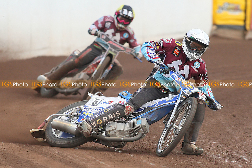 Heat 4: Lakeside pair Piotr Swiderski (white) and Rob Mear - Peterborough Panthers vs Lakeside Hammers - Elite League Speedway at the Showground, Peterborough - 18/07/11 - MANDATORY CREDIT: Gavin Ellis/TGSPHOTO - Self billing applies where appropriate - 0845 094 6026 - contact@tgsphoto.co.uk - NO UNPAID USE.