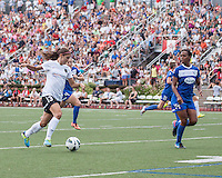 In a National Women's Soccer League Elite (NWSL) match, Portland Thorns FC defeated the Boston Breakers, 2-1, at Dilboy Stadium on July 21, 2013.  Portland Thorns FC forward Alex Morgan (13) drives the ball towards the Breaker's goal with Boston Breakers defender Cat Whitehill (4) and Boston Breakers defender Kia McNeill (14) racing to defend.