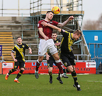 James Collins of Northampton Town win an aerial battle with Andy Parrish of Morecambe during the Sky Bet League 2 match between Northampton Town and Morecambe at Sixfields Stadium, Northampton, England on 23 January 2016. Photo by David Horn / PRiME Media Images.