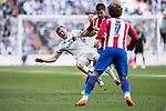 Toni Kroos (l) of Real Madrid battles for the ball with Gabriel Fernandez Arenas, Gabi, of Atletico de Madrid during their La Liga match between Real Madrid and Atletico de Madrid at the Santiago Bernabeu Stadium on 08 April 2017 in Madrid, Spain. Photo by Diego Gonzalez Souto / Power Sport Images