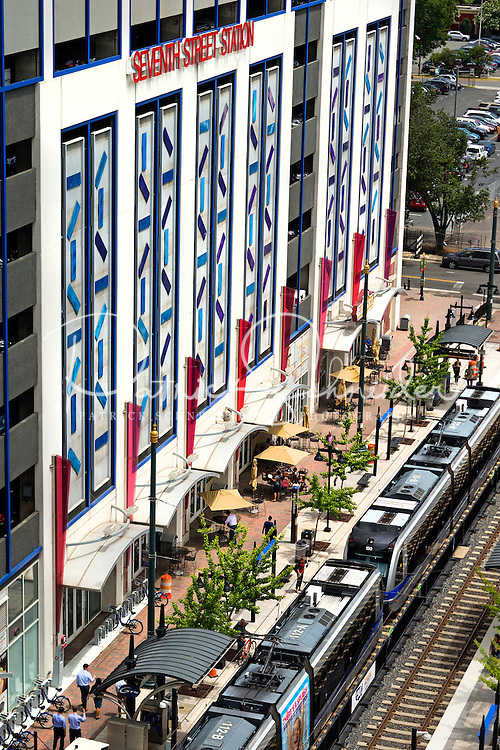 Photography of the Touch My Building at the  7th Street Parking deck in downtown Charlotte, North Carolina. <br /> <br /> 7th Street station is a light rail station for the LYNX Blue Line in Uptown Charlotte, North Carolina<br /> The entire facade of the Bank of America's 7th Street Parking Deck is transformed by two principle visual elements. The first addresses the scale of the building—a syncopated pattern of 416 colored panels painted in custom automobile colors create a lively dynamic surface over the nine-story facade. Natural light is used with colored glass in both the stair tower and the cornice, creating strong.<br /> <br /> Charlotte Photographer -PatrickSchneiderPhoto.com