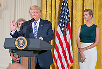 United States President Donald J. Trump makes remarks at an event with small businesses in the East Room of the White House in Washington, DC on Tuesday, August 1, 2017.  Looking on from left is Administrator of the Small Business Administration (SBA) Linda McMahon and from the right is Ivanka Trump. Photo Credit: Ron Sachs/CNP/AdMedia