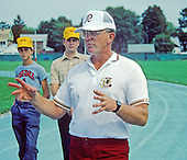 Washington Redskins coach Joe Gibbs speaks to a group of fans during a break in training camp at Dickinson College in Carlisle, Pennsylvania on August 12, 1986.<br /> Credit: Ron Sachs / CNP