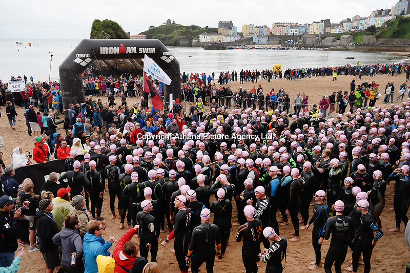 Pictured: Ironman athletes prepare to take to the sea in Tenby Pembrokeshire, Wales, UK. Sunday 10 September 2017<br /> Re: The Ironman Wales triathlon has returned to Pembrokeshire for a sixth time.<br /> More than 2,000 endurance athletes are taking on one of the most challenging courses in the sport, starting and finishing in Tenby.<br /> It includes a 2.4 mile (or 3.8km) swim, a 112 mile (or 180km) bike ride and 26.2 mile (or 42km) run within 17 hours.